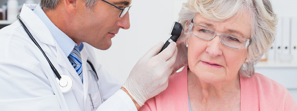 ear nose and throat doctor looking into a woman's ear